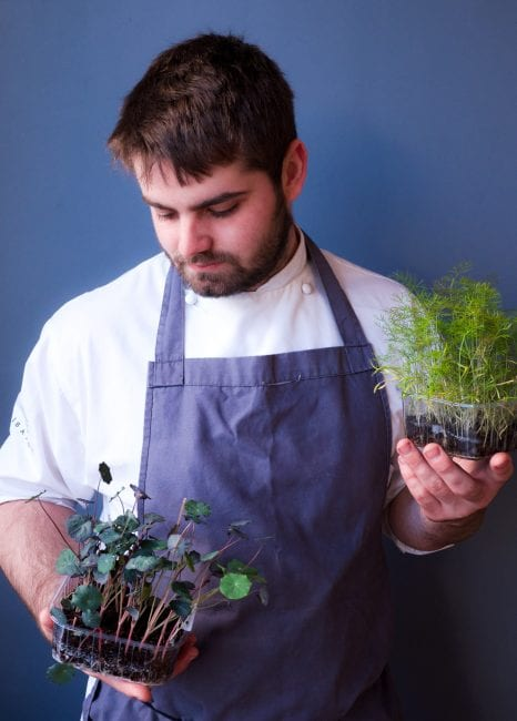 Isaac with some of his home grown herbs